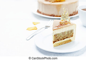 Banana caramel mousse cake with milk chocolate glaze....