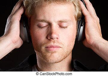 Pojke, hörlurar, musik