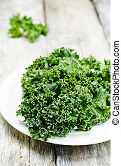 kale salad on a wood background tinting selective focus