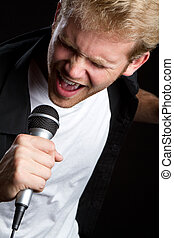 Man Singing - Young man singing into microphone