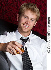 Man Drinking - Young man drinking alcohol