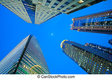 Looking up at Shanghai modern city buildings backgrounds of...