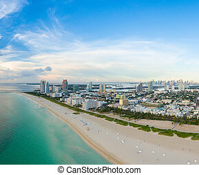 Aerial view of Miami South Beach with hotels and coastline....