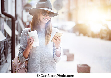 Joyful smiling woman using smart phone
