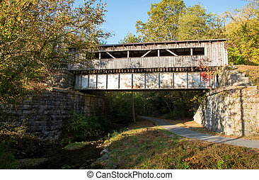 Covered Bridge - A covered bridge in the mountains in early...