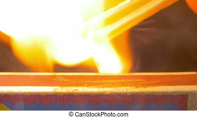 Ignition Three Matches on Matchbox. Slow Motion in 96 fps....