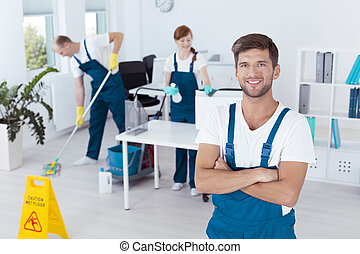 Man working for cleaning company - Image of young man...