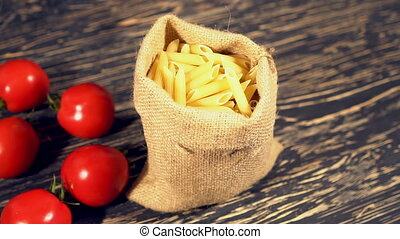 Tomato and pasta on wooden background - Tomato and pasta on...
