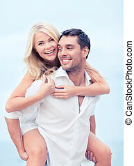 couple having fun on the beach - summer holiday, vacation,...