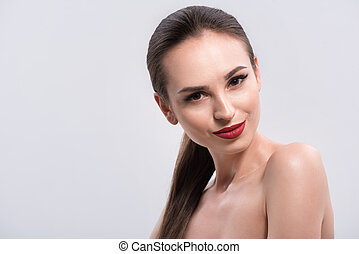 Young woman with red lips and nails in studio - Makeup and...