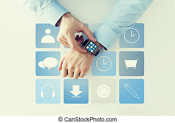 hands with application icons on smart watch - business,...