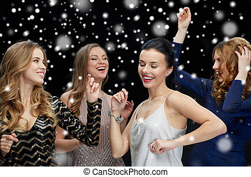happy young women dancing at night club disco - party,...