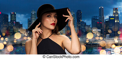 beautiful woman in black hat over singapore city - people,...