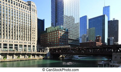 Chicago Riverwalk with a transit train - The Chicago...