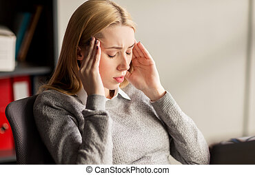 close up of businesswoman with headache at office -...