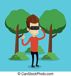 Man wearing virtual reality headset in the park. - Young...