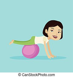 Young woman exercising with fitball. - Young cheerful...