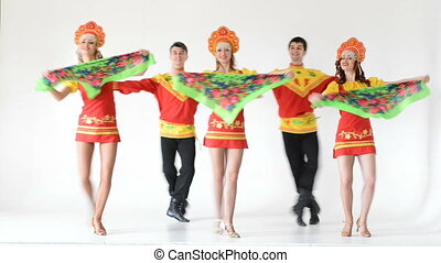 Dancer team wearing a folk costumes isolated on white -...