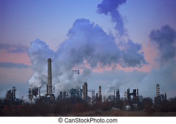 Flock of Birds Flying By Smoke Stacks - Flock of birds...