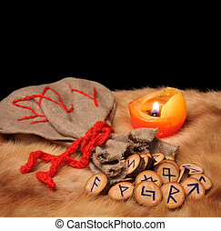 Runes, pouch and candle with copy space - runes, pouch and...