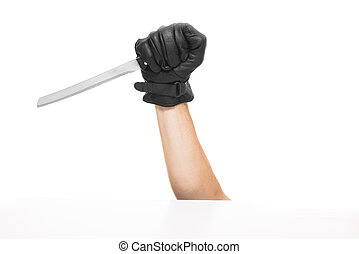 Hand hoding khife - The hand is holding the knife with black...