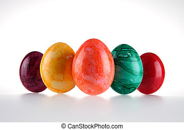 Colored eggs - Five colored eggs on a white background