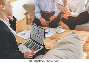 Group of businesspeople working in office - Their meeting is...
