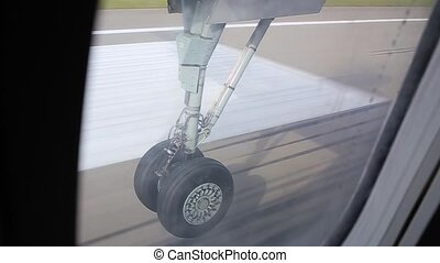 view of the chassis through an airplane window.