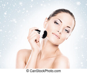Makup portrait of a woman on a snowy background - Face of...