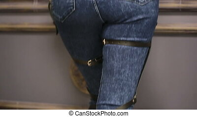 girl in jeans with leather garter new fashion trends straps...