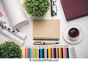 Workplace with blank notepad - Top view of workplace with...