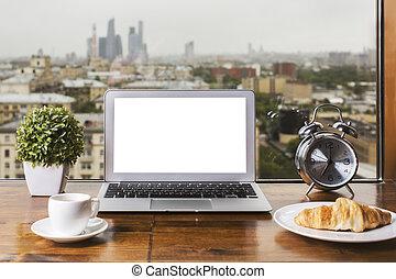 White laptop on windowsill - Wooden windowsill with blank...