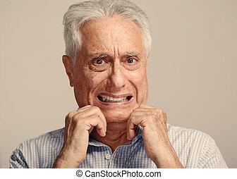 Scared old man. - Scared afraid elderly man portrait over...