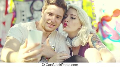 Sexy young blond woman pouting for a selfie with her...
