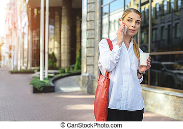 Business woman walking on street - Time to stroll Beautiful...