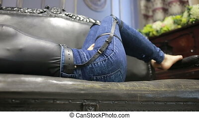 girl in jeans with leather garter new fashion trends. straps...