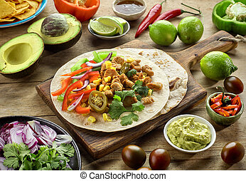 Mexican food ingredients on wooden table