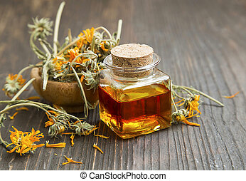 Calendula oil bottle with dried flowers