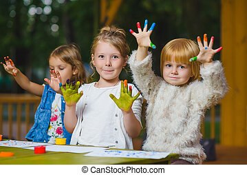 Children having fun painting with finger paint