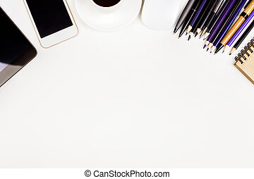 Table with supplies, coffee and gadgets - Top view of white...