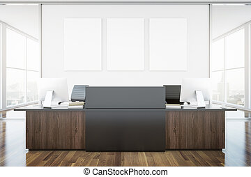 Wooden brown reception desk and blank banner in interior...