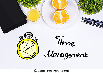 Time management concept - Top view of white table with...