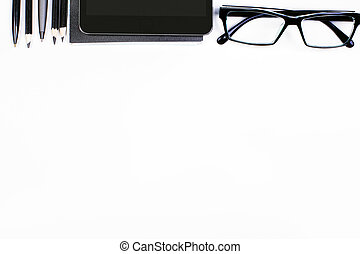 Desktop with gadgets and supplies - Top view of white...