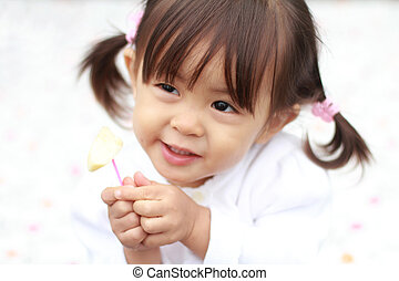 Japanese girl eating an apple (1 year old)