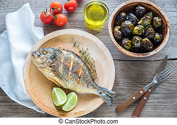 Grilled Dorade Royale Fish with fresh and baked vegetables -...