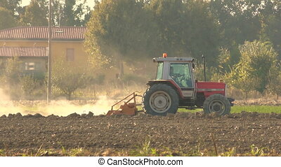 tractor plowing a field in the plains before winter