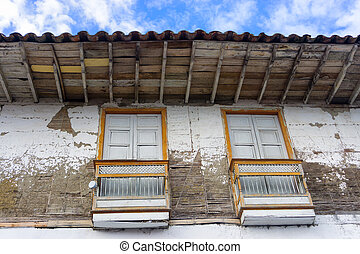 Old Damaged Colonial Architecture - Old run down colonial...