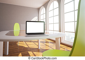 White laptop in modern interior