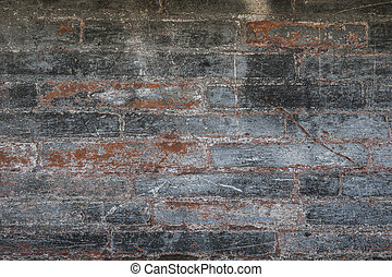Antique brick wall with red bricks showing though layers of...