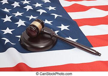 Studio shot of judge gavel and soundboard laying over USA...